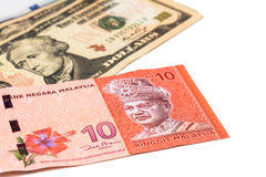 Close up of Malaysia Ringgit currency note against US Dollar Royalty Free Stock Images