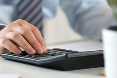 Close up of male accountant making calculations Royalty Free Stock Photography