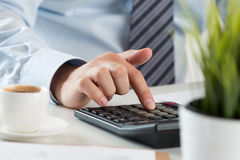 Close up of male accountant making calculations Royalty Free Stock Photos