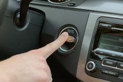 Close up of male arm starting his car Stock Image