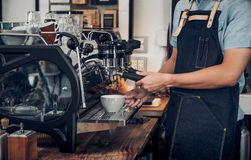 Close up male barista making hot coffee with machine at counter. Bar in cafe restaurant,Food and drink service concept Royalty Free Stock Images