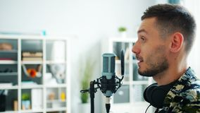Close-up of male blogger recording audio podcast for online blog talking in mic. Close-up of male blogger attractive guy recording audio podcast for online blog stock footage