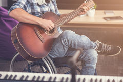 Close up of male body sitting on wheelchair Royalty Free Stock Photo