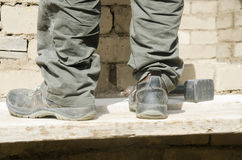 Close up of male boots dirty of work in the construction site Stock Photo