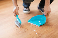 Close up of male brooming wooden floor Royalty Free Stock Photo
