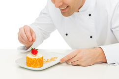 Close up of male chef cook decorating dessert Royalty Free Stock Images