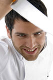 Close up of male chef holding knife Stock Images