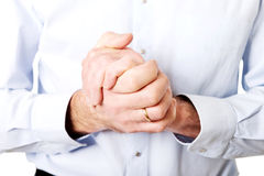 Close up on male clenched hands Royalty Free Stock Image