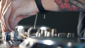 Close-up. Male dj behind the turntables. stock footage