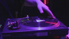 Close-up of male DJ hand scratching vinyl record on sound deck. Stock footage stock video footage