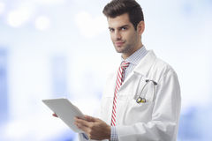 Close-up of a male doctor hands holding tablet Royalty Free Stock Photo