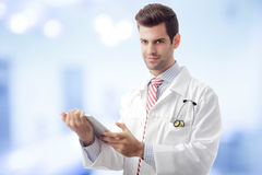 Close-up of a male doctor hands holding tablet Stock Photography