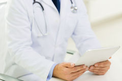 Close up of male doctor hands with tablet pc Stock Photography