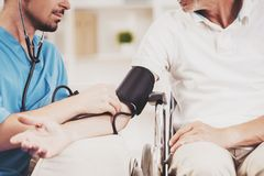 Close up. Male Doctor Measuring Blood Pressure stock photos