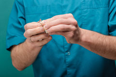 Close-up of male doctor`s hand give white tablets. blisters of pills Stock Photos