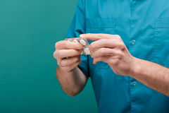 Close-up of male doctor`s hand give white tablets. blisters of pills Stock Photo