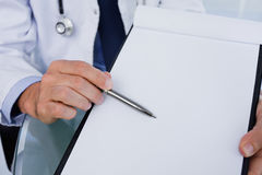 Close up of a male doctor showing a blank document Royalty Free Stock Photos
