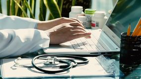 Close-up of a male doctor using a computer keyboard. Close-up of a male doctor using a computer keyboard stock video