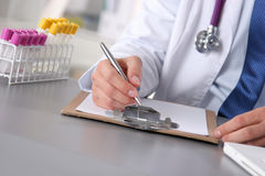 Close up of male doctor writing prescription paper.  Stock Photography