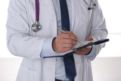 Close up of male doctor writing prescription paper.  Stock Photos