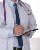 Close up of male doctor writing prescription paper.  Stock Photo