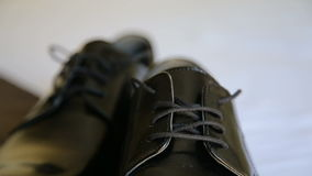 Close up of male dress shoes, elegance wedding groom boots stock video