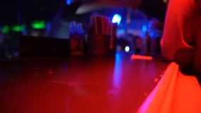 Close-up of male drinking glass alcohol at bar counter in night club, nightlife. Stock footage stock footage