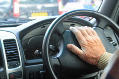 Close up of a male driver pressing the car horn Stock Photography