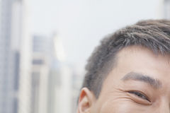 Close Up of Male Eye and Face Smiling in Beijing Stock Photography