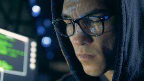 Close up of male face in glasses while hacking. 4K stock footage