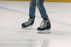 Close up male feet in skates. On ice Stock Photo