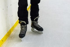 Close up male feet in skates on ice Stock Photos