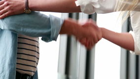 Close up of male and female colleague shaking hands stock footage