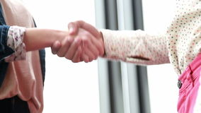 Close up of male and female colleague shaking hands stock video footage