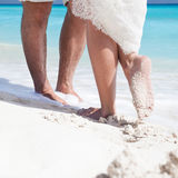 Close up male and female feet on the sand. Close up male and female feet on white sand, kissing Stock Photo