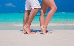 Close up male and female feet on white sand. Beach Stock Images