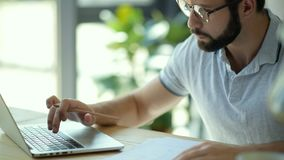 Close up of male freelancer working from home stock footage