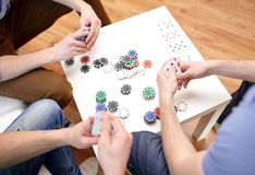 Close up of male friends playing cards at home Royalty Free Stock Photo