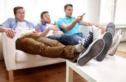 Close up of male friends watching tv at home Stock Photo