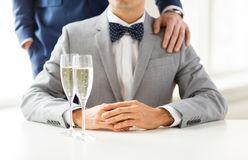 Close up of male gay couple with champagne glasses. People, celebration, homosexuality, same-sex marriage and love concept - close up of happy married male gay Royalty Free Stock Photos