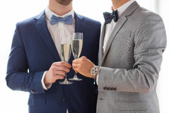 Close up of male gay couple with champagne glasses. People, celebration, homosexuality, same-sex marriage and love concept - close up of happy married male gay Royalty Free Stock Photography