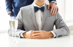 Close up of male gay couple with champagne glasses. People, celebration, homosexuality, same-sex marriage and love concept - close up of happy married male gay Stock Photo