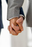 Close up of male gay couple holding hands Royalty Free Stock Image