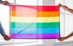 Close up of male gay couple holding rainbow flag Royalty Free Stock Images