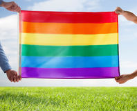 Close up of male gay couple holding rainbow flag Stock Photo