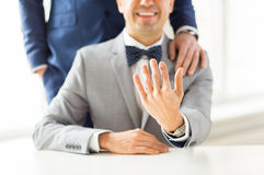 Close up of male gay couple with wedding rings on Stock Images