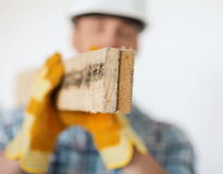 Close up of male in gloves carrying wooden boards Stock Photography