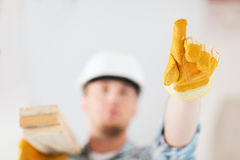 Close up of male in gloves carrying wooden boards Stock Images