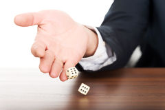 Close up male hand with dices on double sixes Royalty Free Stock Image