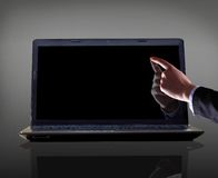 forefinger pointing at laptop Stock Photos